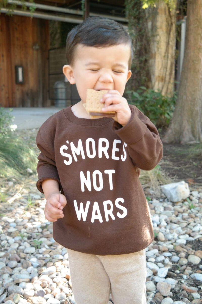 a child eating s'mores